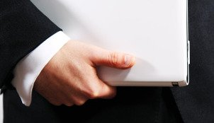 Man carrying project management report folder
